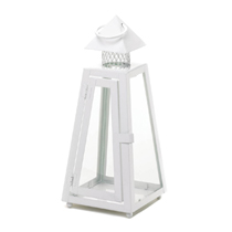 This stunning iron candle lantern shows off the architectural detailing, and the clear glass panels will let the light from your favorite candle shine bright. This candle lantern is alluring set on a tabletop or hanging from its top loop. The white finish lends itself to being equally at home in a modern setting as it is in a charming cottage or bungalow.