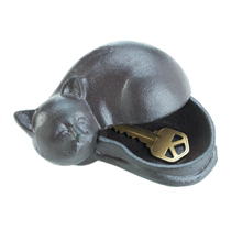 This cat holds a secret that can keep you from getting locked out of your house! Made of cast iron, this napping feline sculpture opens to reveal the purr-fect hiding spot for your spare key.
