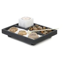 "Take a quiet moment to reflect on what's truly important in your life and calm your senses. This beautiful Zen garden set features a tealight candle holder, light-colored sand, a small rake, and the largest rocks read ""Live"", ""Laugh"" and ""Love"". Tealight candle not included."