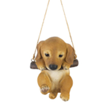 Enjoy a daily dose of cuteness with this hanging puppy figurine. Suitable for indoor and outdoor display, this figurine features an adorable golden lab puppy hanging from a log swing. Hang this dog figurine from your kitchen window or front porch to instantly brighten up your day.