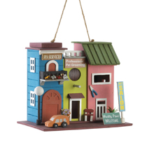 "Make your backyard come to life with this cute pet salon birdhouse. Made from durable eucalyptus wood, this decorative birdhouse features a fun design of a pet salon in bright pastel colors. Your outdoor space will look bright and cheerful with this painted birdhouse. Bird hole and clean out hole are 1.25"" diameter."